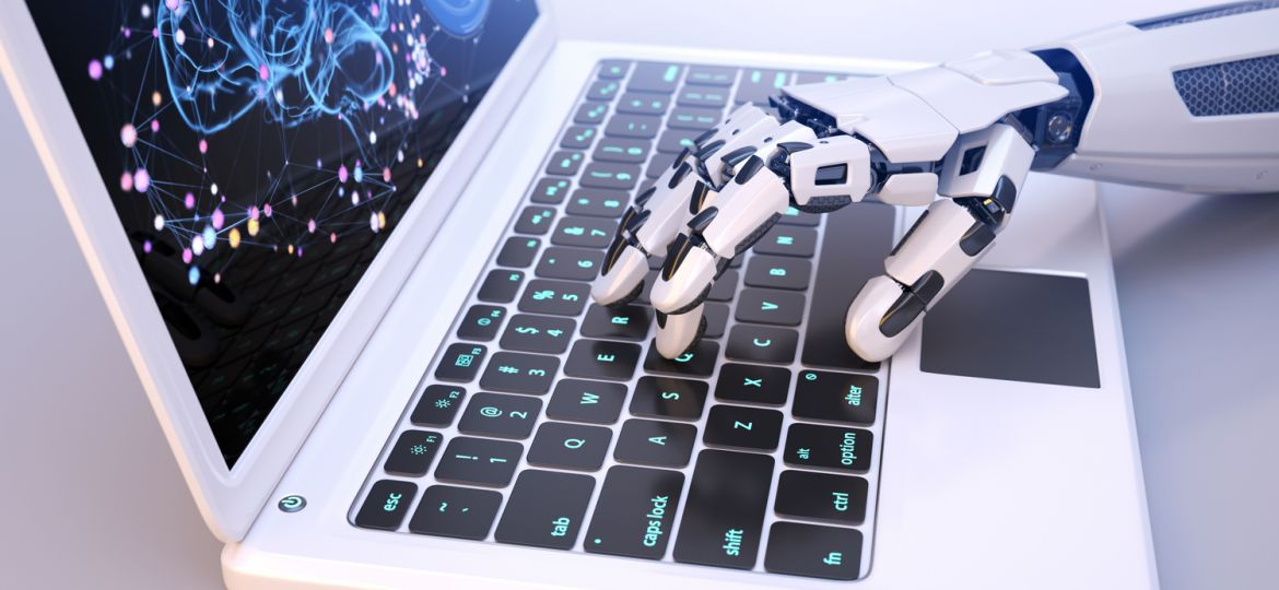 Robot's hand typing on keyboard